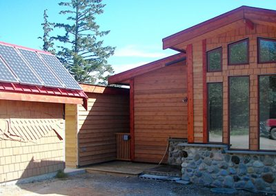 Custom log house with solar panels