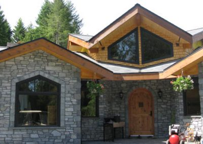 Entryway stonework and roof detail
